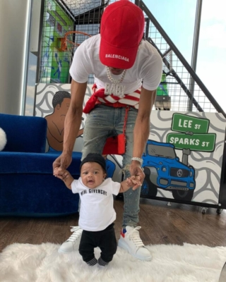 Lil Baby With His Son Wearing A Red Balenciaga Hat Amiri Jeans Alexander Mcqueen Sneakers Off White Hoodie And Red Louis Vuitton Chain Wallet