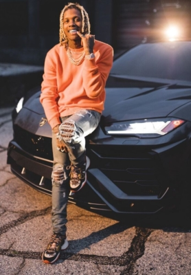 Lil Durk Leans On His Urus In A Heron Preston Sweater Amiri Jeans And Louis Vuitton Sneakrs
