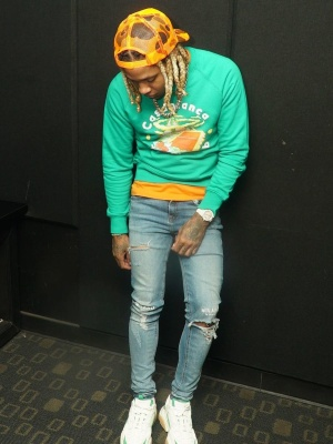 Lil Durk Wearing A Casablanca Sweatshirt With Milano Di Rogue Jeans And Amiri Sneakers