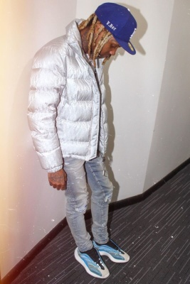 Lil Durk Wearing A Dior Silver Oblique Puffer With Amiri Jeans And Yeezy Sneakers