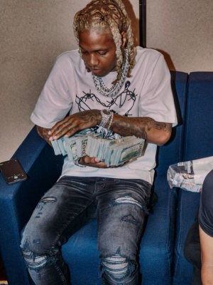Lil Durk Wearing A Dolce Gabbana Tee With Amiri Mx1 Jeans And Sneakers