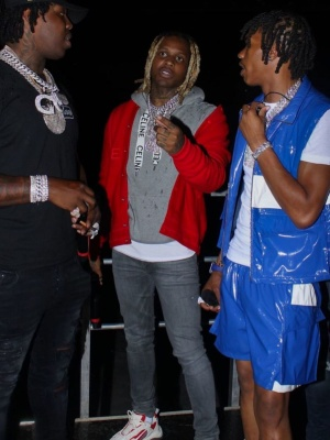 Lil Durk Wearing A Givenchy Red Bomber Ajcket With A Celine Grey Drawstring Hoodie