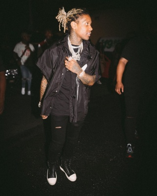 Lil Durk Wearing A Gucci Poncho Amiri Jeans And Rick Owens High Tops