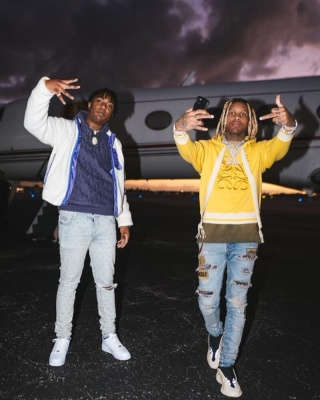 Lil Durk Wearing A Loewe Hoodie With Amiri Jeans And Yeezy Sneakers