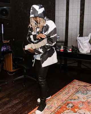 Lil Durk Wearing A Louis Vuitton Black And White Print Jacket With Loewe High Top Sneakers
