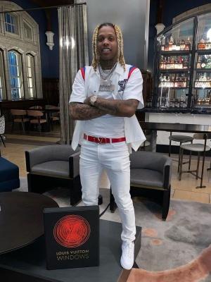 Lil Durk Wearing A Louis Vuitton Bowling Shirt With A Valentino Belt White Jeans And Nike Air Force 1s