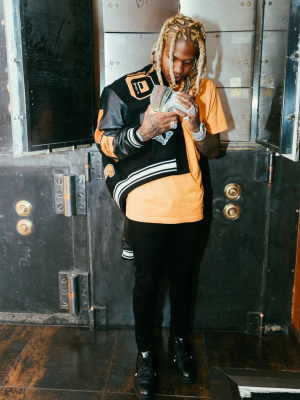Lil Durk Wearing An Off White Varsity Jacket With A Dior X Peter Doig Tee Black Jeans And Louis Vuitton Sneakers