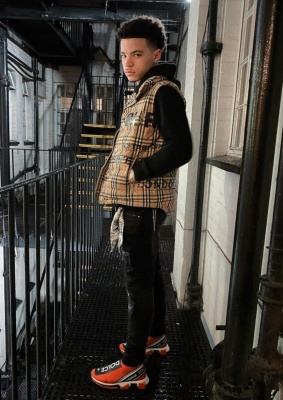 Lil Mosey Wearing A Burberry Puffer With An Amiri Key Ring And Dolce Gabbana Slip On Sneakers