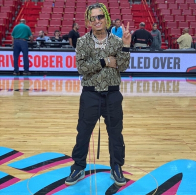 Lil Pump At The Miami Heat Game In Balenciaga Sunglasses With A Palm Angles Jacket Fog Pants And Nike Cactus Jack Afs