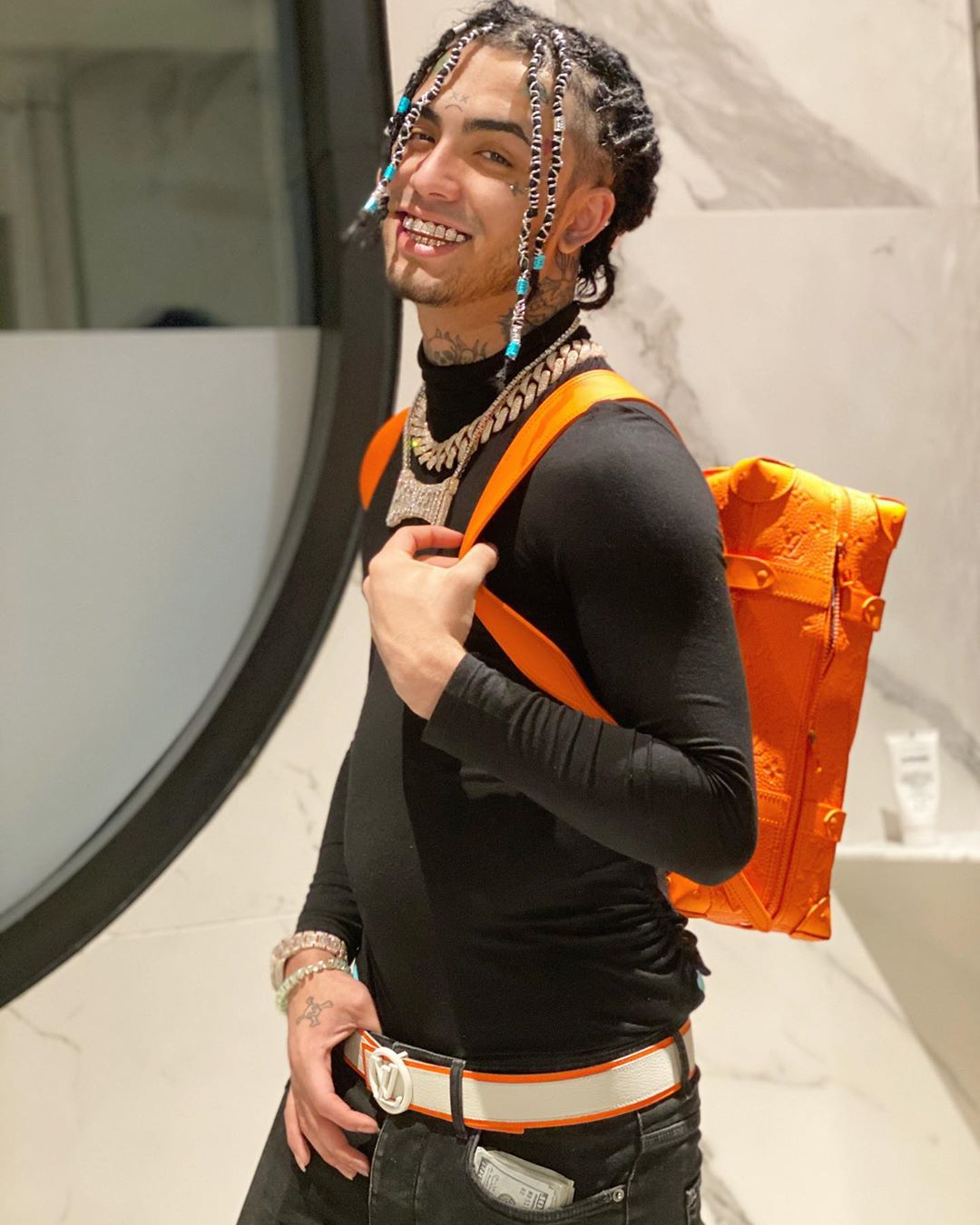 Lil Pump Smiles For The Camer In Louis Vuitton Backpack And Belt
