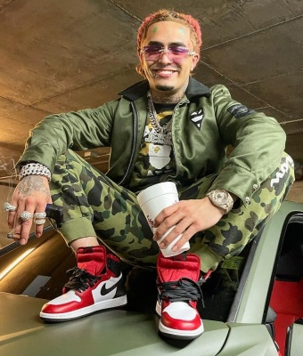 Lil Pump Wearing A Bape Hoodie With Bape X Champion Camo Pants And Jordan 1 Sneakers