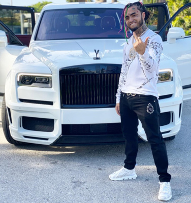 Lil Pump Wearing A Dolce Gabbana White V Neck Sweater Black Jeans And White High Top Sneakers
