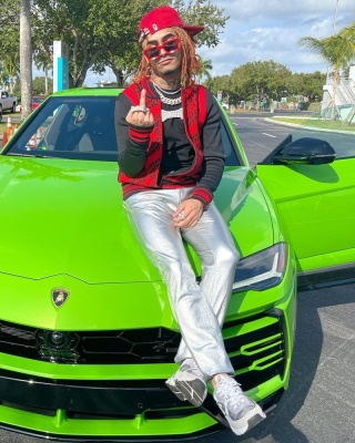 Lil Pump Wearing A Givenchy Jacket With Louis Vuitton Sunglasses Silver Pants And Chanel Sneakers