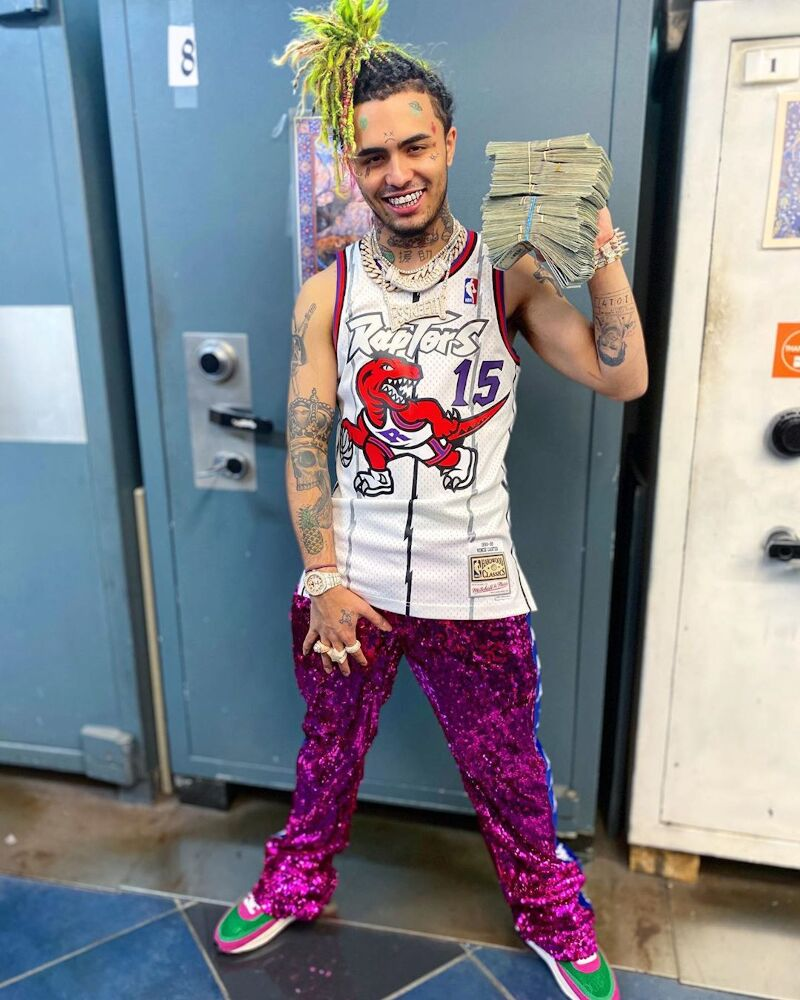 Lil Pump Wearing A Vince Carter Jersey Purple Sequin Pants And Nike X Sacai Waffle Racers