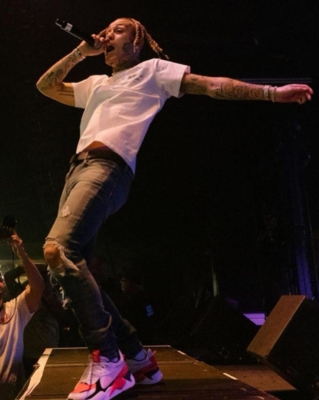 Lil Skies Performing In Ripped Jeans Puma Sneakers And A White T Shrit