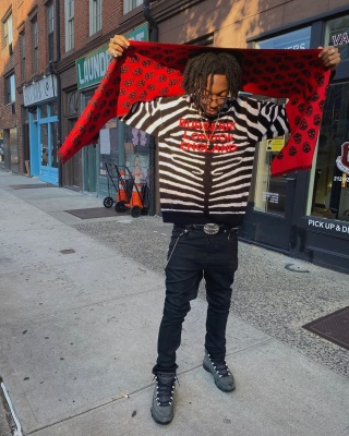 Lil Tecca Wearing A Burberry Zebra Sweater Alexander Mcqueen Scarf Chrome Hearts Belt And Jordan 5s