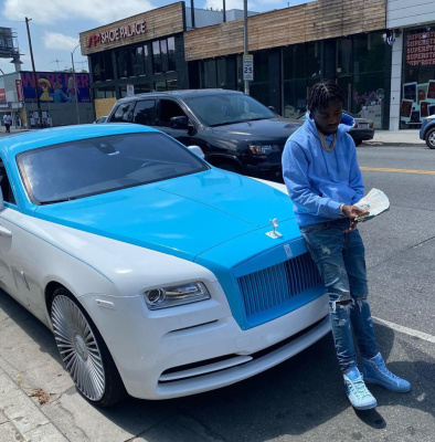 Lil Tjay Matches His Rolls Royce In A Helmut Lang Hoodie And Dior Sneakers