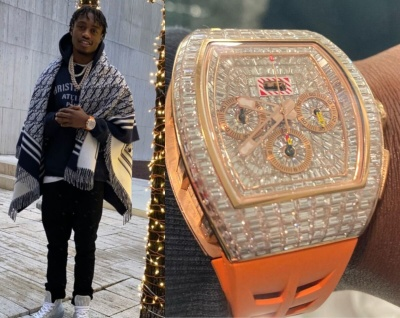 Lil Tjay Wearing A Dior Blanket Wrap With A Black Atelier Hoodie Black Skinny Jeans And Grey High Tops With A Richard Mille Watch
