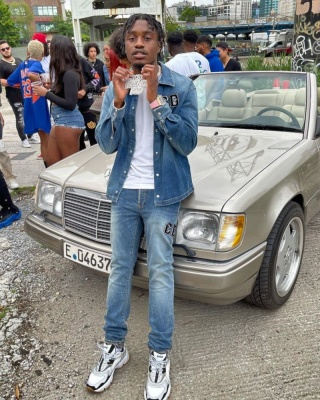 Lil Tjay Wearing A Dior X Kenny Denim Shirt And Jeans With Dior White Black And Grey Sneakers
