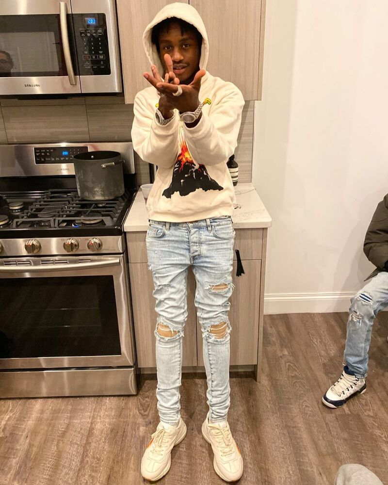 Lil Tjay Wearing A Gucci Hoodie And Amiri Jeans