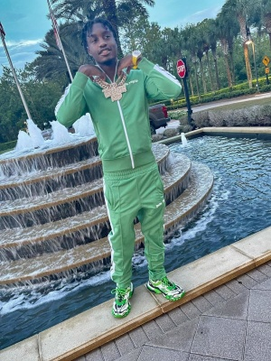 Lil Tjay Wearing A Light Green Palm Angels Tracksuit With Balenciaga White Neon Green And Balck Track Sneakers