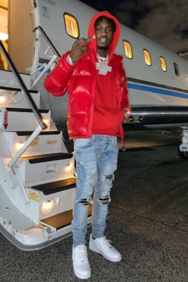 Lil Tjay Wearing A Moncler Puffer With A Red Dior Icon Hoodie Amiri Jeans And Nike Air Force 1 Sneakers