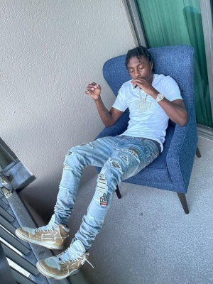 Lil Tjay Wearing An Amiri Biker Patch Jeans With Amiri Light Brown High Top Skeleton Sneakers