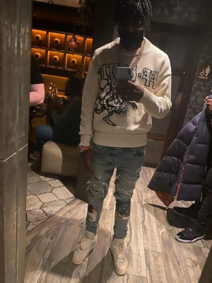 Lil Tjay Wearing An Off White Sweater With Amiri Scarved Patch Jeans And Jordan X Off White Sneakers