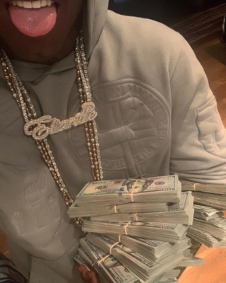 Lil Uzi Showing Off His Cash In A Grey Louis Vuitton Hoodie