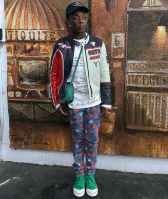 Lil Uzi Vert Weairng Gucci Strawberry Jeans Green Chanel Sneakers A Leather Jacket And Goyard Bag
