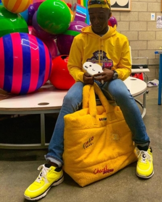 Lil Uzi Vert Wearing A Balmain X Beyonce Hoodie Prada Sunglasses With Yellow Chanel Sneakers And A Ywllow Chanel Tote
