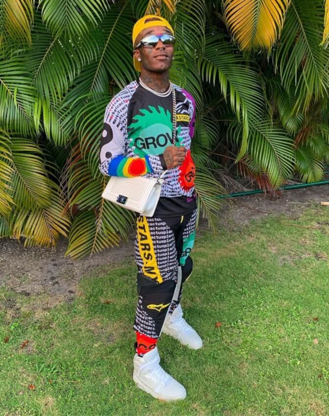 Lil Uzi Vert Wearing A Cactus Plant Flea Market X Alpinestars Racing Suit With Lv Sneakers And Prada Sunglasses