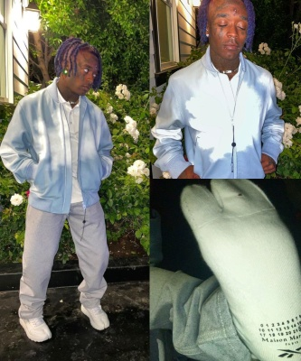 Lil Uzi Vert Wearing A Louis Vuitton Clouds Bomber Jacket With Grey Pants And Maison Margiela X Reebok Sneakers
