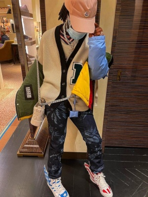 Lil Uzi Vert Wearing A Moncler Hat With Two Tone Cardigan Moncler X Jw Anderson Jacket Chanel Bag Jeans And Adidas X Jeremy Scott Usa Sneakers