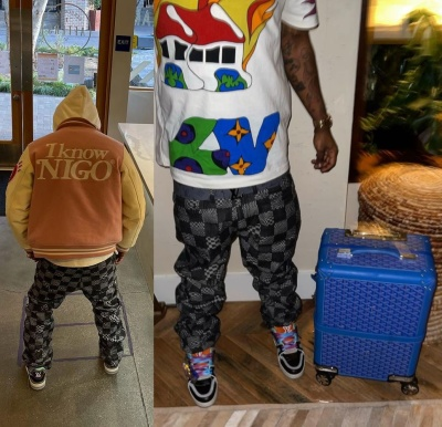 Lil Uzi Vert Wearing A Nigo Pink Varsity Jacket With Louis Vuitton Jeans Sneakers And T Shirt With A Goyard Suitcase