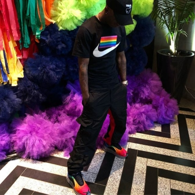 Lil Uzi Vert Wearing A Nike Betrue T Shirt And Sneakers With Black Pants And An Undercover Hat