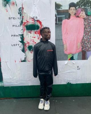 Lil Uzi Vert Wearing A Prada T Shirt Jacket Pants Socks And Sneakers