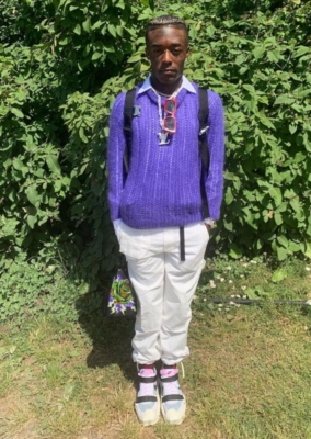 Lil Uzi Vert Wearing A Purple Prada Sweater With Louis Vuitton Red Sunglasses Black Prada Belt Bag Alyx Backpack And Nike Sneakers