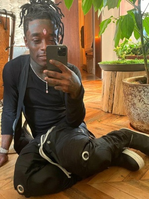 Lil Uzi Vert Wearing A Rick Owens Black Cargo Vest Black Long Sleeve Tee Black Knee Pad Pants And Black Slip On Boots