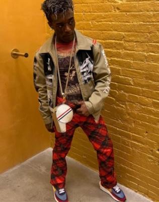 Lil Uzi Vert Wearing A Takahiro Miyashita Tan Jacket Red Tartan Pants Thom Browne Bag Jpg Vintage Shirt And Sacai X Nike Sneakers