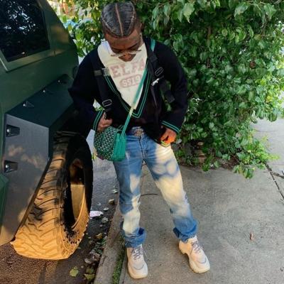 Lil Uzi Vert Wearing A Telfar Sweater Goyard Bag Lv Sunglasses Prada Sneakers And Patek Philipe Watch
