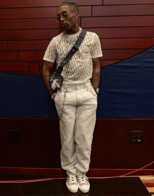 Lil Uzi Vert Wearing A White Dior Oblique Shirt With A Dior X Sorayama Bag And Sneakers And White Pinstripe Pants