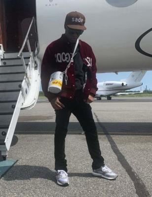Lil Uzi Vert Wearing Off Whtie Sneakers Black Pants Rebel Gods Bomber Jacket With Louis Vuitton Sweatshirt Polo Bag And Sunglasses
