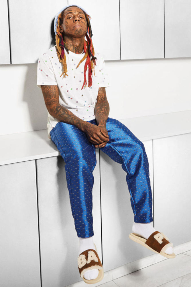Lil Wayne Wearing A White Saint Laurent Allover Star Print T Shirt Pleasures Blue Optical Pants And Bape X Ugg Slides