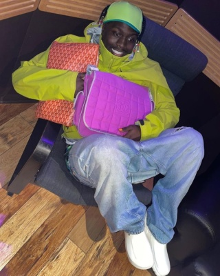 Lil Yachty Wearing An Arcteryx Yellow Jacket With A Chanel Bag And Orange Goyard Bag