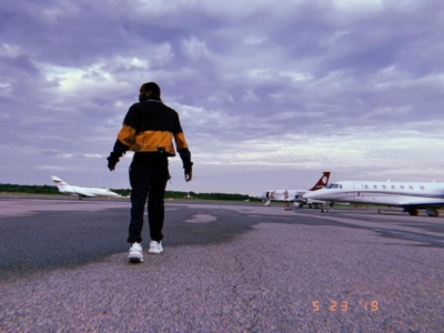 Meek Mill Boarding A Plane In An Off White Denim Jacket Black Pants And Balenciaga Sneakers