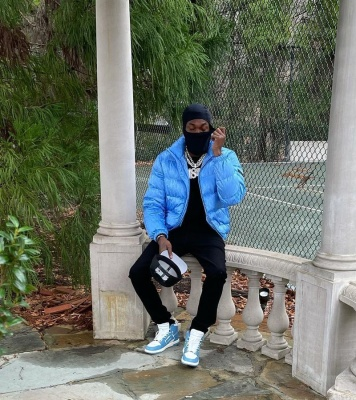 Meek Mill Wearing A Dior Light Blue Puffer And Amiri High Top Skeleton Sneakers