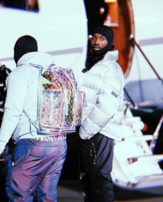Meek Mill Wearing A Dior Oblique Puffer Along Side His Jet