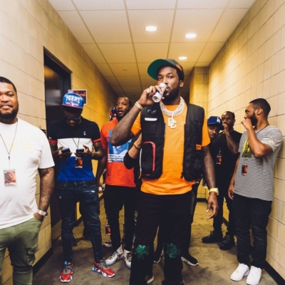 Meek Mill Wearing An Oragne Heron Preston T Shirt And Black Vest Pre Show
