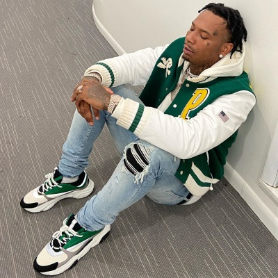Money Bagg Yo Wearing A Palm Angels White Green Varsity Ajcket With Amiri Jeans And Dior Sneakers